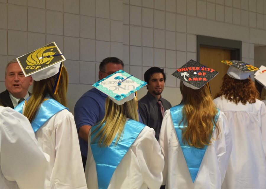 The students showing their caps off while waiting to walk into the ceremony.