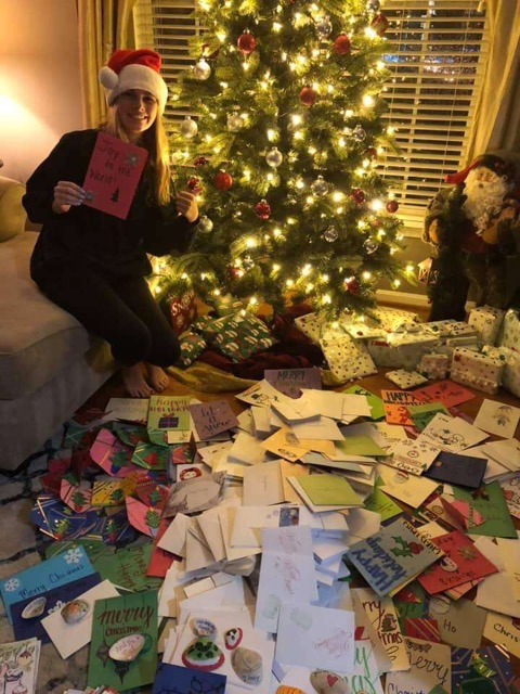 Hannah Mourlas pictured with holiday cards before distribution to nursing homes.
