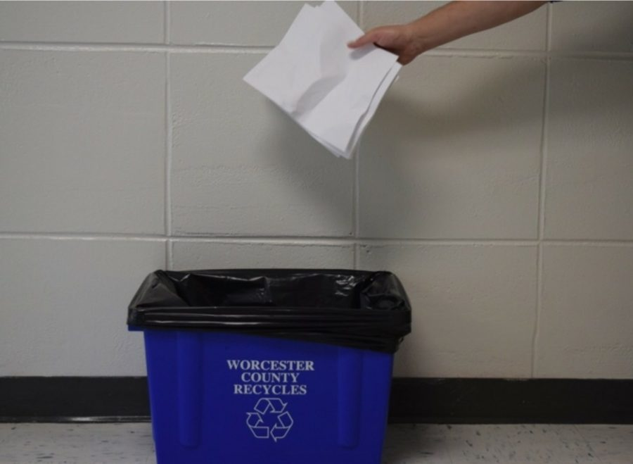 These+blue+bins+have+been+placed+around+the+school+to+collect+paper+products.+