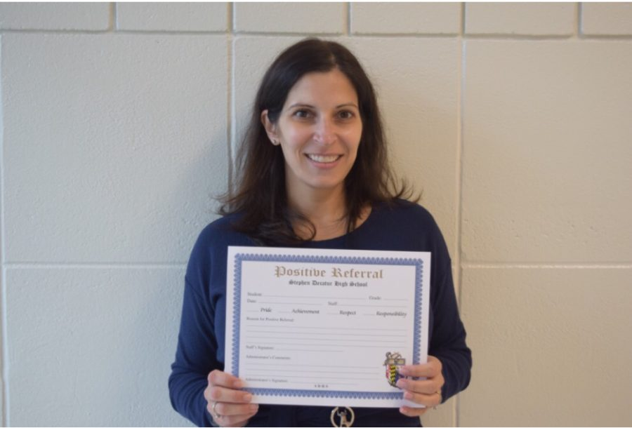 Mrs.Putman holding a Positive Referral.